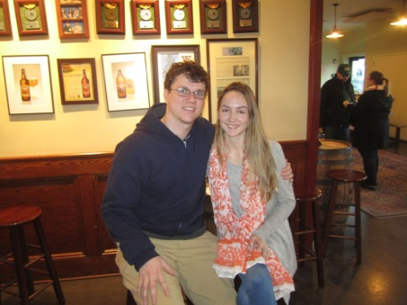a couple smiling for the camera in the beer hall