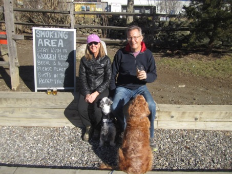 couple with their dogs in the beer garden