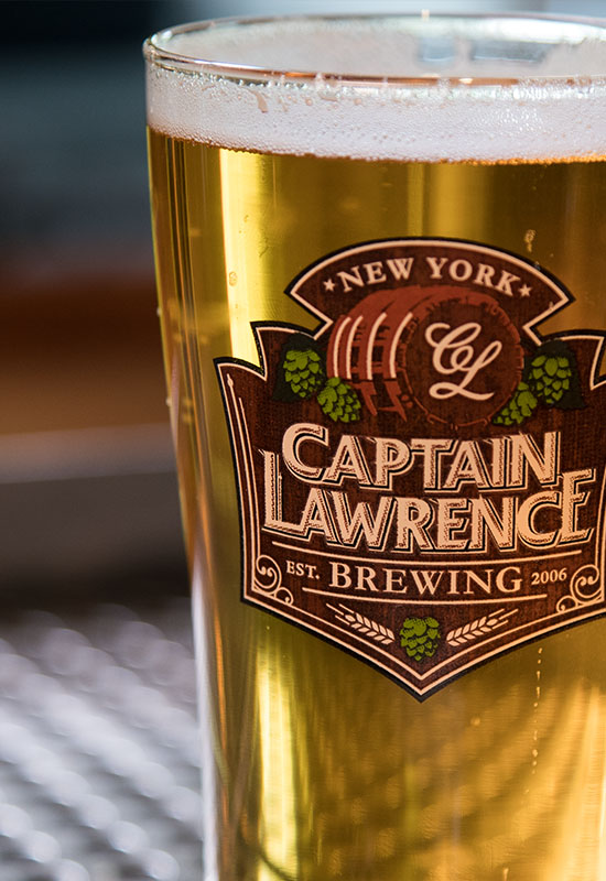 filled captain lawrence labeled pint glass