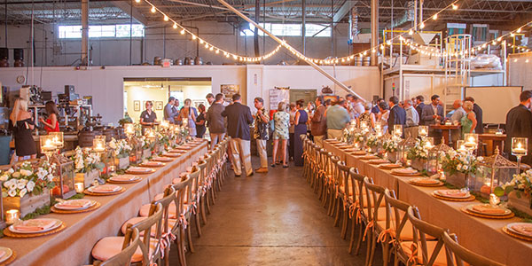 wide shot of a wedding rehearsal in the brewery space