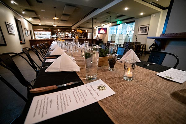 Tables set up for event in tasting room