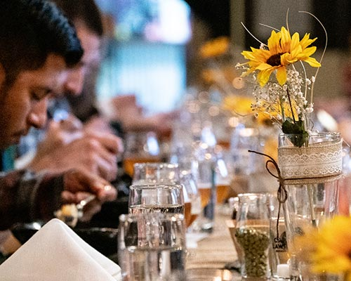 Man sitting at table, table spread with sunflowers