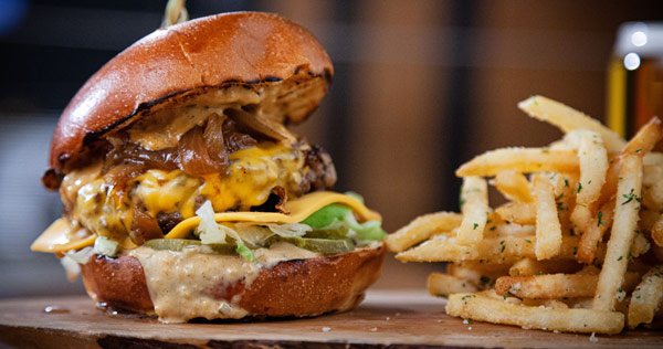 fries and a cheese burger with caramelized onions